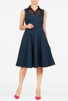 A point collar and tulle yoke tops our cotton poplin dress, nipped in at the…