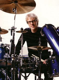Stewart Copeland of The Police.  Had people tell me I play like him.  Probably cuz I played all the Police songs over and over as a young teen. H is one of my fav drummers