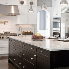 Love this! White kitchen with black island.