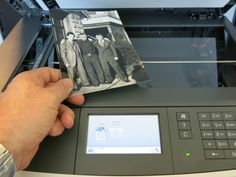 FREE SCANNING! What to Do with Those Old Family Photos, Letters, and Documents (Lexmark Scanner Patron Placing Photo)