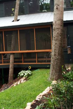 Eccentric Truehome spanning a small creek. It welcomes the woods into the home. Sentient Architecture, LLC