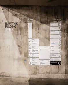 Tate Modern, London - wayfinding on concrete. The three shadow lines make this photograph for us