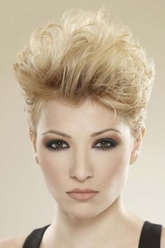 Feminine 80's styled haircut with close cropped sides