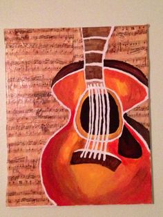 I printed out old music sheets on tissue paper and glued it on the canvas before painting the guitar!!! Looks amazing!!