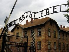 "Auchwitz in Poland.  The German inscription over the entrance reads ""Arbeit macht frei"" (Work will make you free).  Don't know if this was a method of controlling the thousands of people marching to their deaths, or just a cruel joke.  I spoke to a veteran who had been part of the unit that liberated one of the camps in the Auscwitz compound.  He said he still had nightmares."