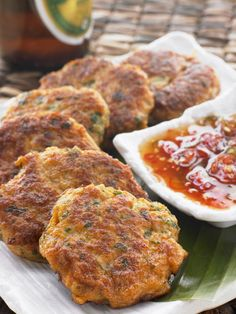 Classic Unbattered Thai Fish Cakes Recipe - Thai Fish Cakes Are A Common Street Food In Thailand Very Flavorful Compared To Most Western Fish Cake Recipes They Arent Battered Which Allows For More Of The Fresh Taste Of The Fish Spices Thai Crab Cakes Recipe, Thai Fish Cakes, Thai Sweet Chili Sauce, Sweet Chilli, Calamari, The Fresh, Street Food, Finger Foods, Food Processor Recipes