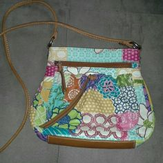 Fossil cross-body purse Approximately 9 1/2 inches wide x 8 1/2 inches long. Multi-colored,  flower designs.  Genuine leather. Used 2x. Very clean on inside. Pic 2 (which is on back of purse) shows were my blue jeans rubbed against purse. It blends in with purse and is not noticeable.  Pic 3 shows water mark on bottom right. Otherwise,  great condition. Fossil Bags Crossbody Bags