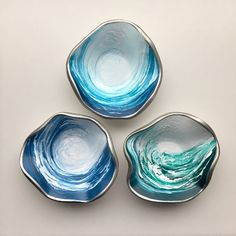 Catch the Waves! A trio of hand sculpted and painted polymer clay trinket dishes designed for those entranced by the beauty of the sea. Art and container made into one; three styles/colors to choose from. ( $30/ ea.) #trinketdish #ringdish #jewelrydish
