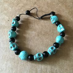 """Turquoise/Black Sugar Skull Bracelet Single strand- adjustable slide strung sizing. Turquoise blue skulls, black separating beads... Conversation piece!  Fits up to a 9"""" wrist. NWOT, purchased from a local artisan in Oregon. Jewelry Bracelets"""