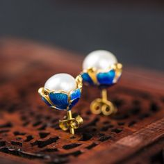 Only $6.97 Free Shipping - Natural Pearl Enamel Solid 925 Sterling Silver Stud Earrings  http://silverbene.com/trendy-freshwater-cultured-natural-white-pearl-blue-cloisonne-enamel-solid-925-sterling-silver-gold-stud-earrings-for-women.html