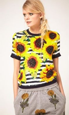 Sequin top by Ashish. Crafted in a pure silk fabric. Featuring a round neckline with a ribbed edge, short sleeves styling with ribbed cuffs, a hand embroidered sunflower and stripe sequin design with a seamless finish, which is achieved by hand stitching each sequin, and an exposed zip fastening to the reverse.