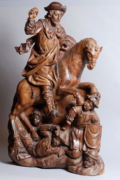 Saint Jacques Matamoros. Equestrian group carved into two components, representing St. Jacques whose horse tramples five Moorish soldiers. The habit of the apostle carries the three shells that are symbolic. Vivacity rendered in gesture and movement of the dress. Hispano-Flemish work of the late sixteenth or early seventeenth century. H. 95; L. 60 cm.
