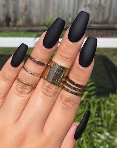 22 Black Nails That Look Edgy and Chic - Simple yet elegant solid black with a matte finish.