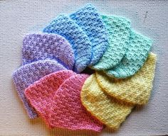 Colorful crochet newborn caps. Project by Craftsy member JeanieK.