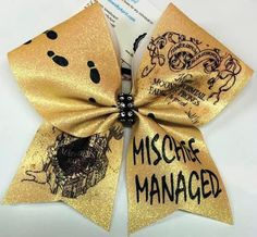 Bows by April - Mischief Managed Harry Potter Glitter Cheer Bow, $20.00 (http://www.bowsbyapril.com/mischief-managed-harry-potter-glitter-cheer-bow/)