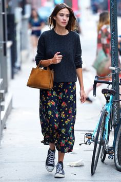 Alexa Chung pairs a floaty floral maxi with trainers for a stylish off-duty look.