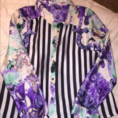Lucy Paris pattern top This top is one of a kind and so edgy while being classy!! I have only worn this one time but all of my students loved it! It's silky and thin with tight wrist cuffs and gold accent buttons✨ Lucy Tops Button Down Shirts