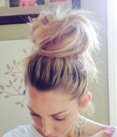 """I PROMISEthis is THE easiest bun to do. I was trying to do this style for so long but got it ALL wrong.  1. Put your hair in a high tight ponytail (dirty hair is best) 2. Separate the hair into TWO sections (right section and left section) 3. Back comb it until there's good texture 3. Simply take ONE section and make a """"C"""" around your pony tail base 4. Pin this section with bobby pins 5. Take the last section and complete the """"C"""" into an """"O"""" and pin Earrings fromthree bird nest"""