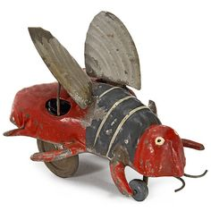 "Günthermann Tin Toy Figure ""Flittering Bee,""   Clockwork-driven, hand-painted tin, moving wings, length 4 1/3 in., working."