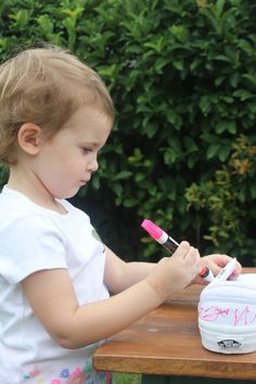 How to use paint markers to decorate a pair of white sneakers - DIY Mother's Day gift idea