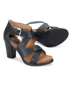 Elevate your warm-weather footwear collection with this sandal featuring bold crisscrossing leather straps and a height-boosting heel. A foam-padded footbed and shock-absorbing cork midsole cushion steps.3.5'' heel with 1'' platformBuckle closureMolded cork midsoleSuede-lined footbed with foam paddingLeather upperLeather liningTPR soleImported