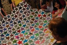 """Amazing """"Star Stories"""" quilt from domesticat.net.  I really like the five-pointed star design and how the fabrics change in tone from one side of the quilt to the other!"""