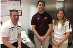 View larger image - Tim Di Mango and Grace Katt, two juniors in CMU's athletic training program, have been honored for their heat exhaustion study. Kevin Miller, their advisor, is at left.