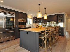 Dark gray kitchen cabinets and light gray walls, light wood floors