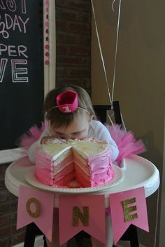 adorable baby attacking her smash cake