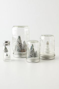 DIY Anthropologie snow globe.  So easy to make and save a bundle they are charging for this simple craft! Hot glue small decorative trees inside the lid of a mason jar, add chunky glitter and 'snow,'  hot glue the lid to the jar.... Voila!