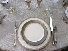 China: Pickard Geneva White Dimmer Plate with a St. Moritz Salad Plate. Crystal: Waterford Lismore essence. Flatware: Sambonet Perles.