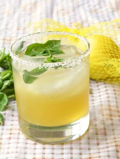 Lemon Basil Margarita Recipe - Who said margaritas had to be just about lime? This one's made with lemon. And what goes with lemon? Basil! We added it. It's good.