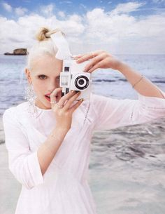 white lomo camera at the beach