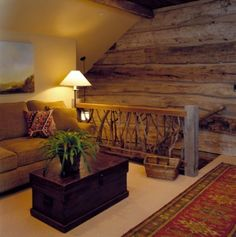 Here branch balusters and a rough hewn handrail work perfectly in the rustic design of this space.