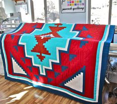 This is a stunning native american quilt pattern inspired by an old weaving from the early 1900s.  Three sizes included with pattern, 27x32 (crib/wallhanging), 55x63 (lap/throw) and 88x94 (Dbl/Queen)  Geometric design. Lots of color possibilities. The finished quilt that you see pictured was pieced and quilted by me, Laurene Farley of Peacock Quilting.  See my other listings for additional native american quilt patterns.