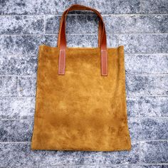 Hand stitched tan suede tote bag with leather strap. $35.00, via Etsy.