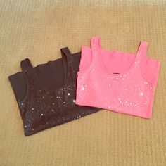 Bundle 2 express tank tops Like new, excellent condition, dark green and pink Express sparkling tank tops.  Ribbed on the back.  100%cotton.  I honestly can't remember ever wearing these, they've been hanging in my closet.  They need a new home!! Express Tops Tank Tops