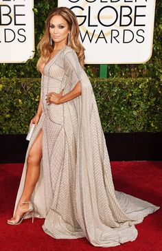 Jennifer Lopez in a jeweled gown and Stuart Weitzman shoes