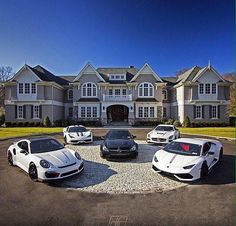 All my luxury sports cars parked in the driveway of our massive mansion! 12 October 2016