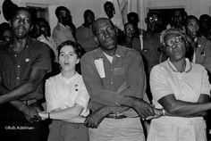 Singing or praying during the Civil Rights Era.