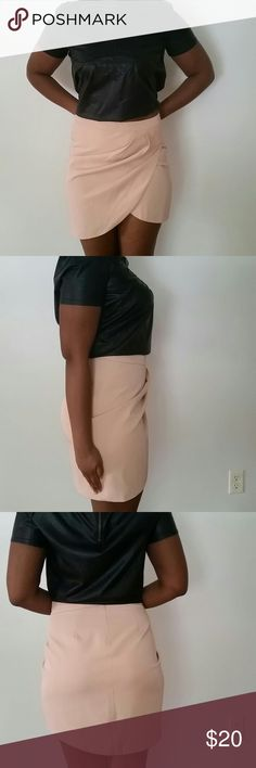F21 blush pink asymmetrical skirt Worn once. Length 19.5 inches at longest point, 15.5 at shortest point. Waist 14 inches.  Concealed zipper on the back. Pleats fall flat, as you can see in the pictures the skirt is too small for me. Forever 21 Skirts Asymmetrical