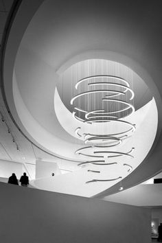 Segmented curved sections of illuminated Aluminium suspended to create a dynamic, yet elegant whirlpool effect. A vertical momentum carries our attention down the height of the installation, emphasising the space of the surrounding interior. A pronounced symmetry is achieved when viewed directly from above or below as the circular lines, previously only delicately hinted at, become complete.