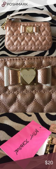 Wristlet bag A rose gold with some cream .. bow in front with heart that says Betsey Johnson .. big enough to fit an iPhone 6 never used.  tags still attached Betsey Johnson Bags Clutches & Wristlets
