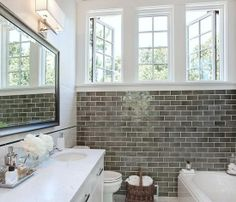 gray tile wall and high windows to let moisture out
