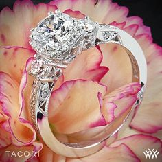 Glamorous and elegant, this three-stone Dantela ring triples the shimmer with a crown of diamonds intensifying the round center diamond. Tacori Dantela Three Stone Engagement Ring