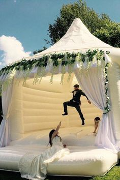 We Have 3 Words For You: Wedding Bouncy Castles! We Have 3 Words For You: Wedding Bouncy Castles!,Wedding Inspiration Wedding Bouncy Castles Are Now a Thing You Can Rent, and Oh My GOSH wedding decorations wedding wedding table decorations wedding Cute Wedding Ideas, Wedding Goals, Wedding Themes, Wedding Day, Wedding Inspiration, Wedding Stuff, Wedding Book, Rustic Wedding, Wedding White