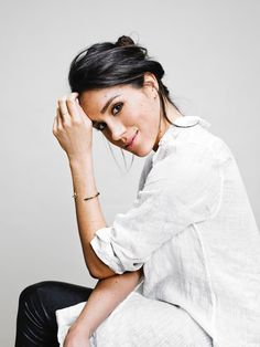 Meghan Markle making the classic white shirt look sexier than ever.