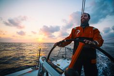 January 27, 2015. Day 24 of Leg 3 to Sanya, onboard Team Alvimedica. The final 50 miles to Sanya are spent in a building breeze at sunrise with MAPFRE and Brunel in hot pursuit, just 8 miles astern. Seb Marsset on the helm at sunrise. Amory Ross/Team Alvimedica/Volvo Ocean Race