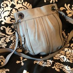 I just discovered this while shopping on Poshmark: B. Makowsky Light Gray Cross Body Leather Bag. Check it out! Price: $32 Size: Medium, listed by laurensandy