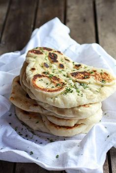 Homemade Naan (with step-by-step photos) use wholemeal flour + fat-free Greek yoghurt